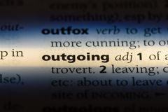 Outgoing. Word in a dictionary.  concept royalty free stock image