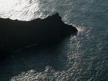 Outgoing rock on the wild beach of Laga, Bizkaia. Aerial sunset photo, Basque Country stock photography