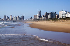 Outgoing Tide Against Durban City Skyline Royalty Free Stock Images