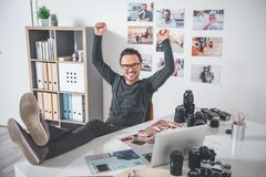 Outgoing unshaven man resting at work stock photos