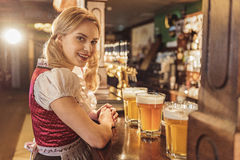 Outgoing woman having job in alehouse Stock Photos
