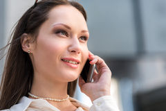 Outgoing woman speaking by phone Royalty Free Stock Images