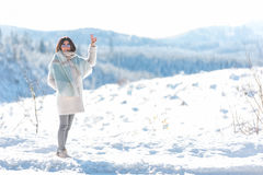 Outgoing woman standing in snow Stock Photos