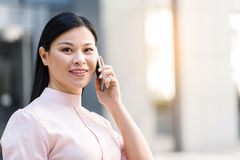 Outgoing woman telling by mobile Stock Photos