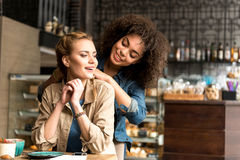 Outgoing women making conversation in cafe Stock Photos