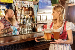 Outgoing young female speaking with man in bar Royalty Free Stock Photography