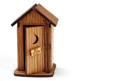Outhouse. Toy model of a wooden outhouse with a moon on the door stock photo