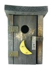 Outhouse/Birdhouse. A harmless little outhouse that really is a birdhouse stock photo