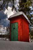 Outhouse in the forest. A red cute outhouse in the middle of the forest Royalty Free Stock Photos