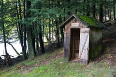 Outhouse in a Forest Royalty Free Stock Photography