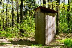 Outhouse in forest royalty free stock photo