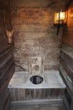 Outhouse Interior royalty free stock photos