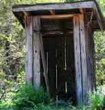 Outhouse nas madeiras Imagem de Stock