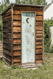 Outhouse. Old brown outhouse with a weathered door Royalty Free Stock Photos
