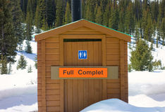An outhouse at a rest area in the rocky mountains Royalty Free Stock Photography