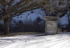 Outhouse in the snow. Abandoned outhouse in the snow Royalty Free Stock Photos