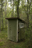 Outhouse toilet in a forest Stock Photos