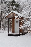 Outhouse in winter Stock Photography