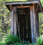 Outhouse in the woods Stock Image