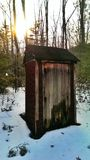 Outhouse in the woods Royalty Free Stock Photo