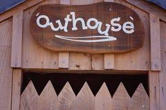 Outhouse znak Nad A Strzępiasty drzwi obraz royalty free