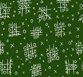 Ouths and crosses on chalkboard seamless. Ouths and crosses on chalkboard - seamless pattern Royalty Free Stock Images