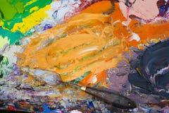 Outil mélangé de couleurs à l'huile et de peinture Photo stock