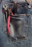 Outils dans une poche Photo stock