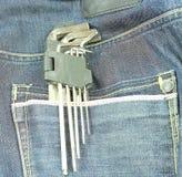 Outils dans une poche de blue-jean Image libre de droits
