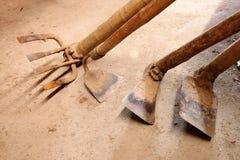 Outils de jardinage ou outil agricole d'utilisation Photo libre de droits