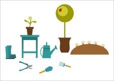 Outils de jardinage sur un fond gris Photo libre de droits