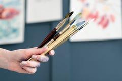 Outils de passe-temps de peinture de loisirs de brosse de lecture d'artiste Photo stock