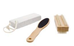 Outils de Pedicure sur le blanc Photo stock