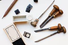 Outils de presse typographique Photographie stock libre de droits