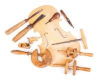 Outils de ventre et de travail de violon photos stock