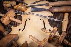 Outils de ventre et de travail de violon images stock