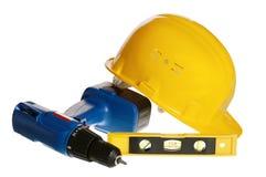Outils et casque du constructeur Photos stock
