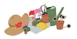 Outils et fleurs de jardin dans des pots Image libre de droits