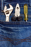 Outils et jeans Images stock