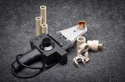 Outils et pièces de rechange pour l'approvisionnement et le chauffage en eau Images libres de droits