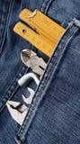 Outils et poche de jeans Images stock