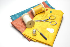 Outils et tissus de couture Photographie stock