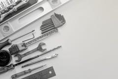 Outils noirs et blancs de construction photographie stock