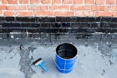 Outils pour l'imperméabilisation Photo stock