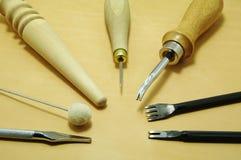 Outils sur le cuir Photo stock