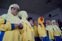 Outing class. Kindergarten students are conducting a outing class  at a traditional market in the city of Solo, Central Java, Indonesia Stock Photos