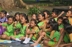 Outing Class Student. Children sing during the outing to the city park in Solo, Indonesia Royalty Free Stock Photography