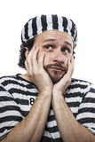 Outlaw, Desperate, portrait of a man prisoner. In prison garb, over white background Stock Photo