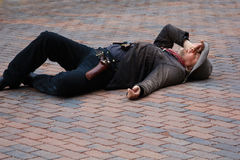 Outlaw on ground during shootout in Deadwood, South Dakota. Man dressed as outlaw and laying on ground during shootout Stock Photography