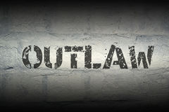 Outlaw WORD GR. Outlaw stencil print on the grunge white brick wall Royalty Free Stock Image